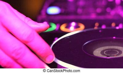 DJ is tweaking the turntable - Closeup of DJ is tweaking the...