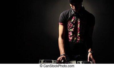 DJ man make music in dark - DJ man playing in dark