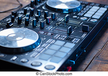 Dj mixer on wooden table close-up.