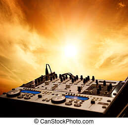 Dj mixer over sky background