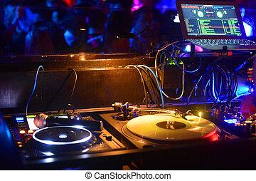 DJ mixer - A dj mixer in a night club