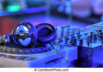 dj mixer with headphones - Djs table with audio equipment in...