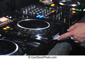 DJ mixing station and turntable - Close up of a DJ in a...