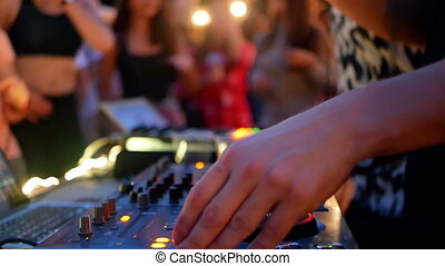 DJ music club dance - DJ plays music at a party in a club at...