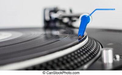 DJ needle on a vinyl record - Closeup of a DJ needle on...