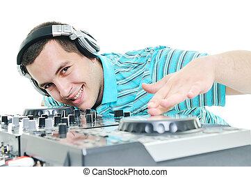 dj party - young dj man with headphones and compact disc dj...