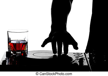 DJ - Close-up hand of a dj on the turntables and a glass of...