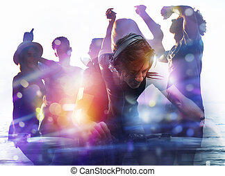 DJ playing music at the discotheque. Double exposure - DJ at...