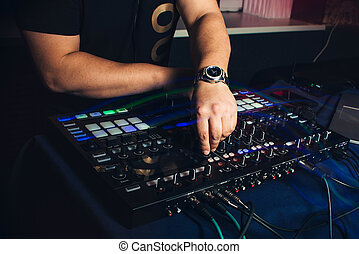 dj hands on mixer hand on a audio dj mixer operating volume