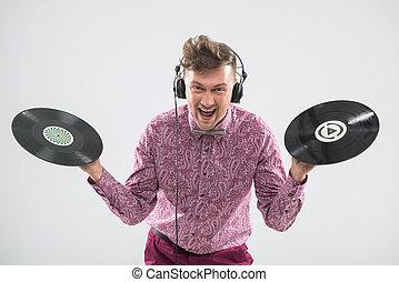 DJ posing with vinyl record