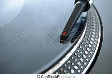 DJ Record Needle - DJ record needle on a 12 inch vinyl LP