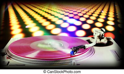 dj record turntable with blurred disco scene in background