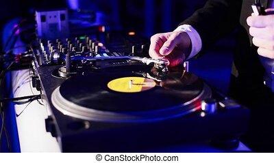 Dj spinning vinyl in a night club