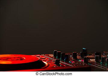 DJ - Dj mixer equipment to control sound and play music.