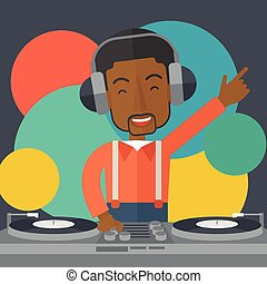 DJ with console. - An african-american DJ wearing headphones...