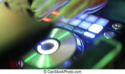 DJ working at the console. Close-up