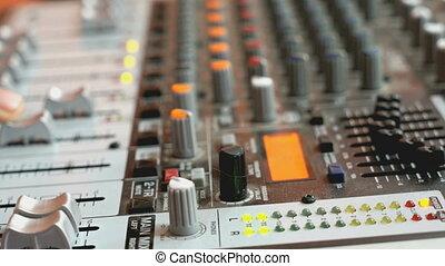 DJ working on a audiomixer at a nightclub
