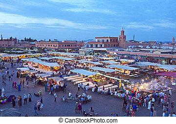 Djemaa el Fna market in Marrakesh, Morocco at sunset