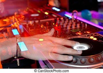 DJ's hands - DJ at work, disco party