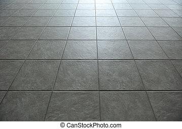 dlaždičkovaná podlaha