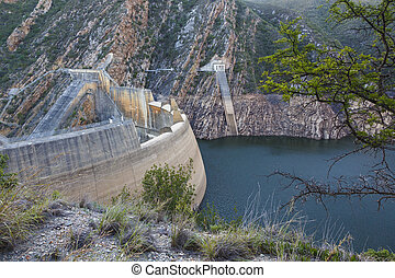 Dm Wall and Dam with Low Water Level - A dam and dam wall in...