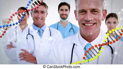 Animation of DNA strands spinning over portrait of group of doctors with stethoscopes wearing lab coats smiling to camera. Global medicine concept digitally generated image.