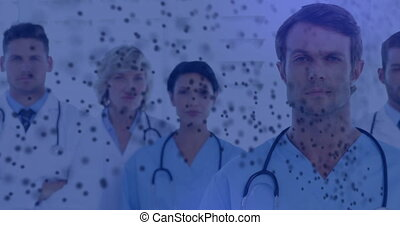 Animation of spinning 3D DNA strand formed with particles over portrait of group of doctors. Global medicine research science concept digitally generated image.