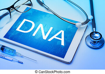 DNA word on tablet screen with medical equipment on...