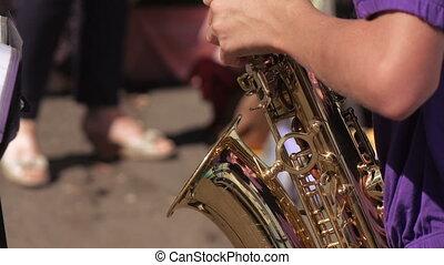 Girl playing saxophone