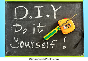 Do It Yourself - D.I.Y , Handwritten with white chalk on a...