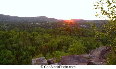 Viewed from a rocky mountain top in boreal forest of Quebec, Canada (Package of 2 scenes, travelling up)