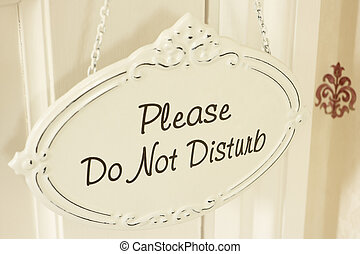 Do Not Disturb Sign Hanging On Door