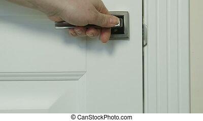 Do not disturb sign on door knob closeup