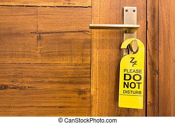 Do not disturb sign on doorknob