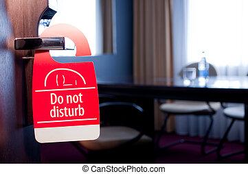 Do not disturb sign on hotel`s door