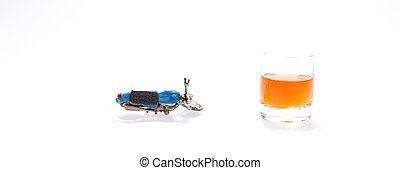Motorcycle next to a glass of brandy