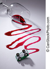 do not drive if drunk - Spilled red wine and a overturned ...