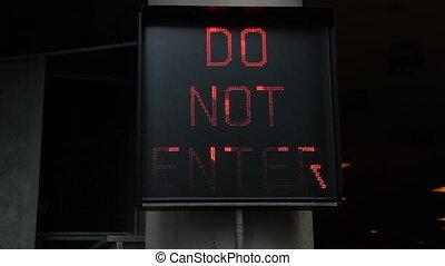 Do not enter. Wide. - Flashing neon Do not Enter sign...