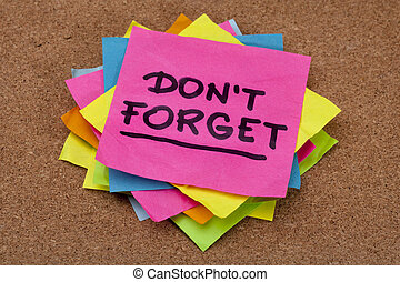 do not forget reminder - a stack of colorful sticky notes on...