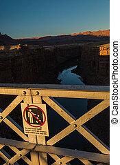 Do not throw rocks sign on the Navajo bridge in Arizona USA