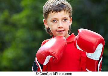 Do not touch me! - Portrait of a little boy in boxing gloves...