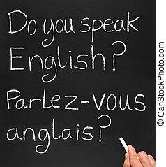 A teacher writing do you speak english in French.
