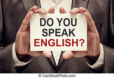 Do You Speak English. Man wearing suit holding a signboard