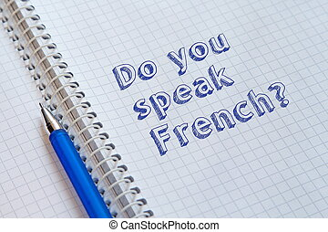 Do you speak French? Text handwritten on sheet of notebook