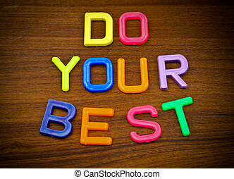 Do your best in colorful toy letters on wood background