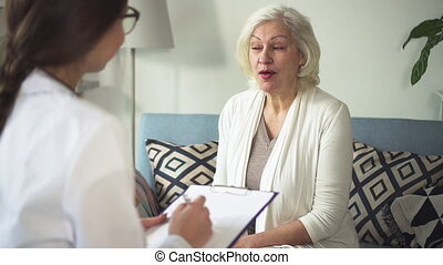 Doc visiting aged woman at her bright home