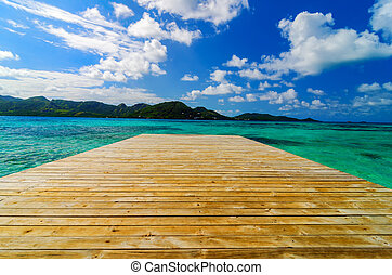 Dock and Beautiful Water - Wooden dock extending out into...