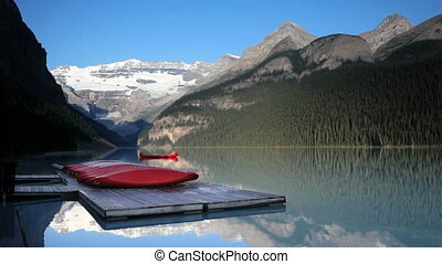 Row of canoes on a dock on Lake Louise, Banff National Park