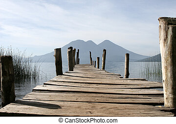 Dock and Volcanoes - A dock overlooking the volcanoes of ...