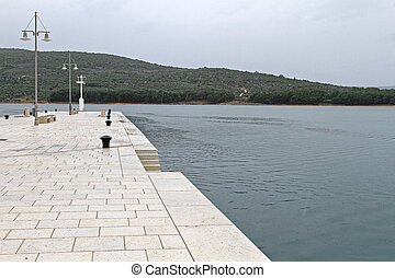 Dock Cres Island - Rainy Day at White Marble Stone Pier in ...